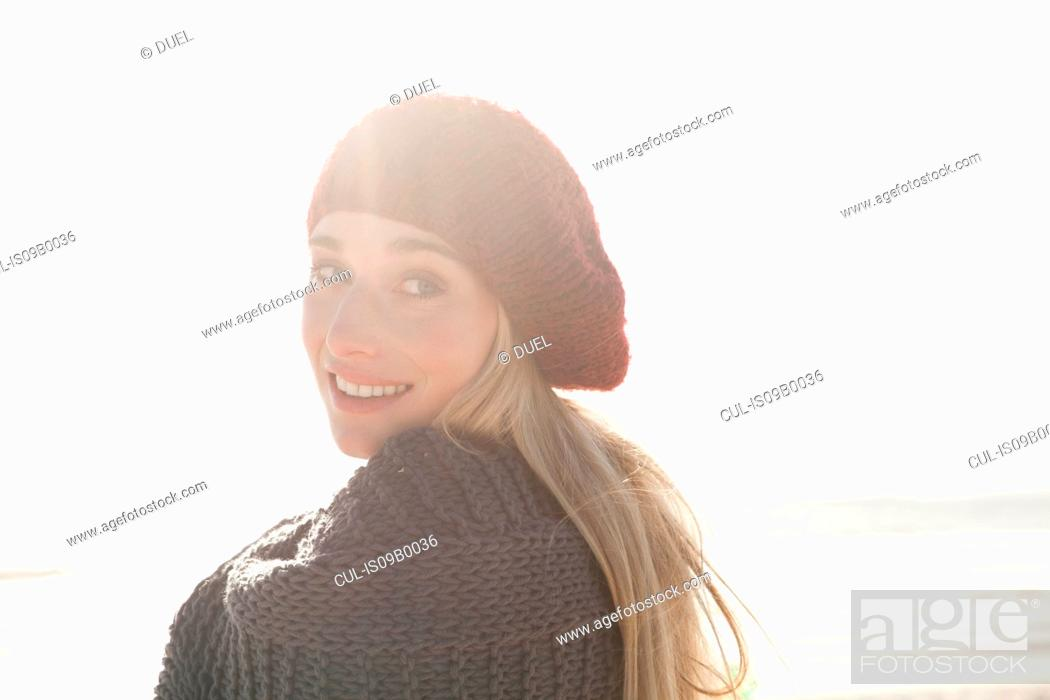 Stock Photo: Young woman in beret enjoying sunny day.