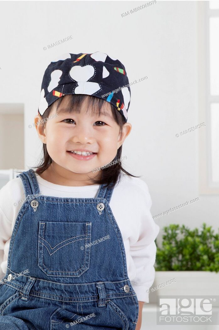 Stock Photo: Little girl smiling at the camera,.