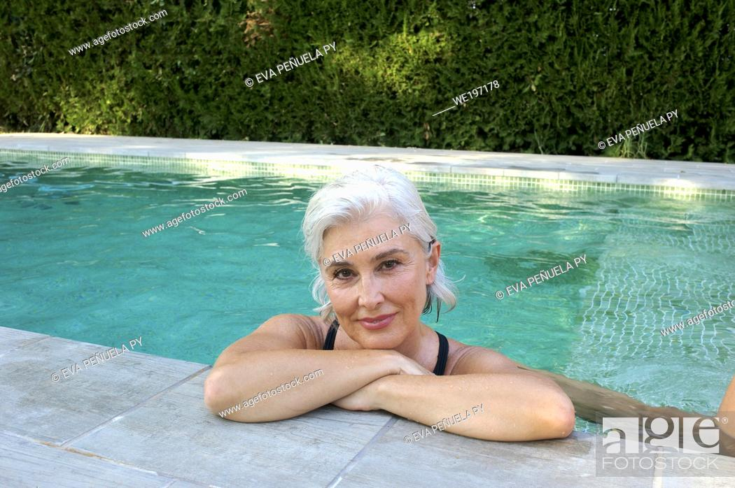 Stock Photo: Sisters meeting in an afternoon by the pool in the country house located in the surroundings of Seville.
