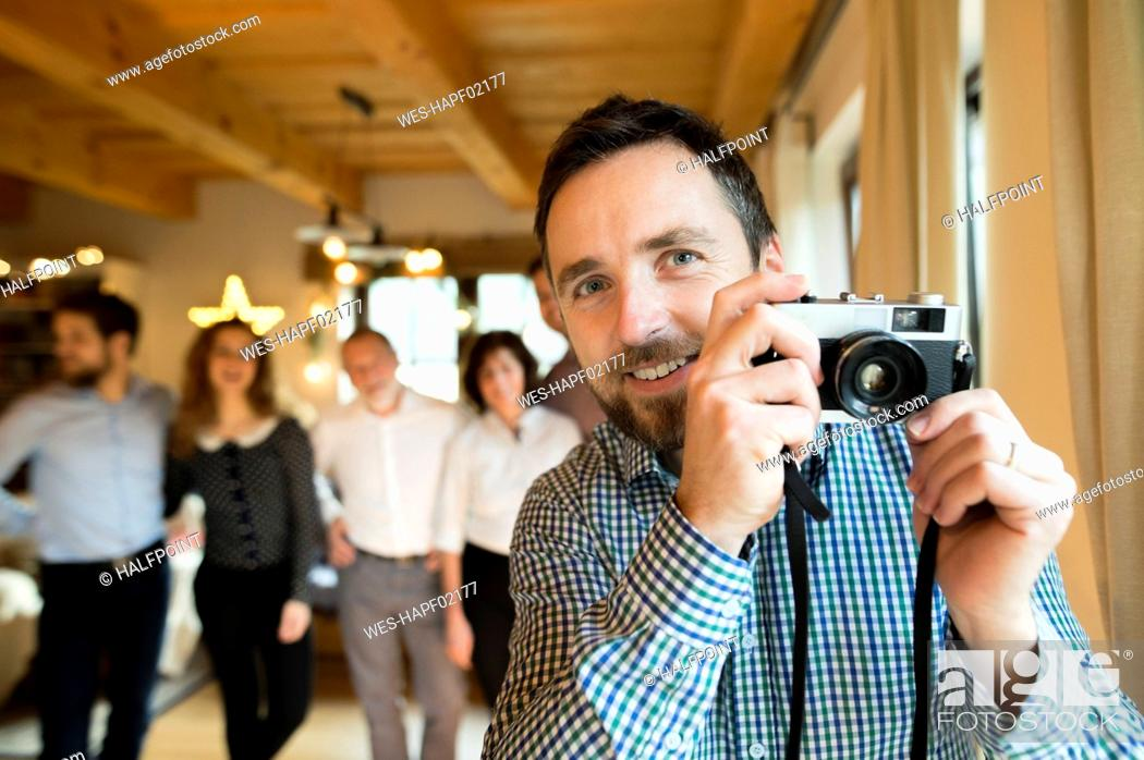 Stock Photo: Photographer with family at home at Christmas.