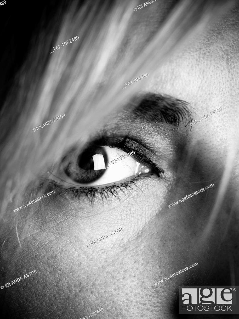 Stock Photo: Close up of the eye of a young attractive caucasian woman, black and white.