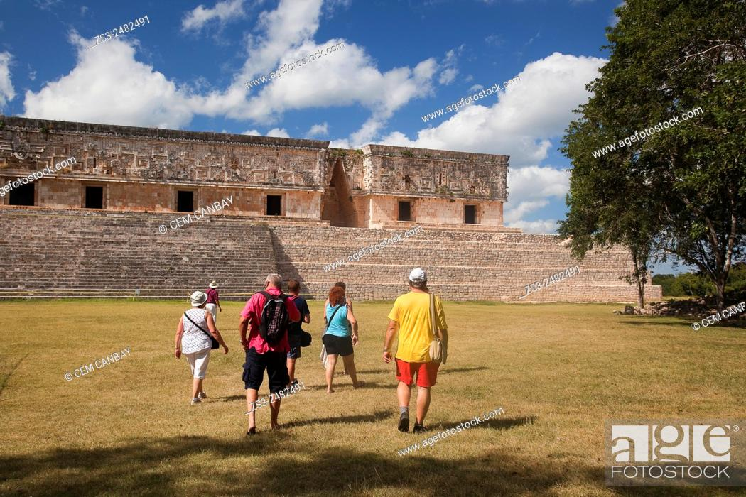 Stock Photo: Tourists in Uxmal Ruins near the Quadrangle Of The Nuns, Yucatan Province, Mexico, Central America.