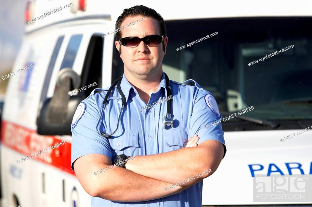 Stock Photo: Paramedic worker standing in front of ambulance portrait.