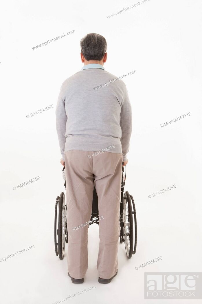 Imagen: Senior man pushing wheel-chair with rear view.