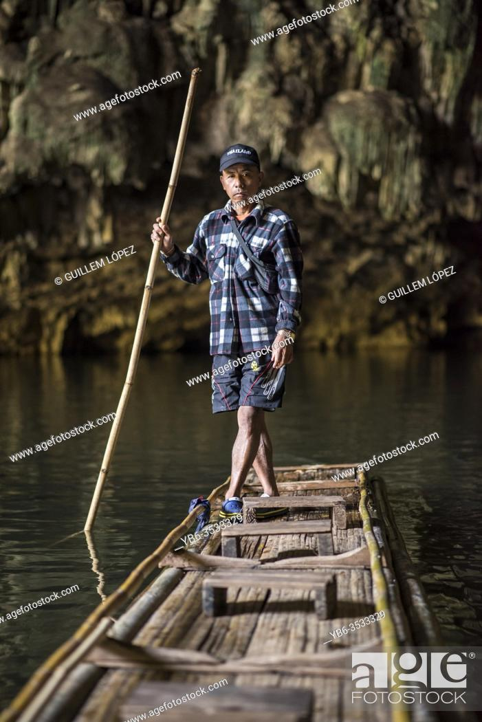 Stock Photo: A boatman at the inside the Tham Lot cave, Pang Mapha, Pai, Thailand.