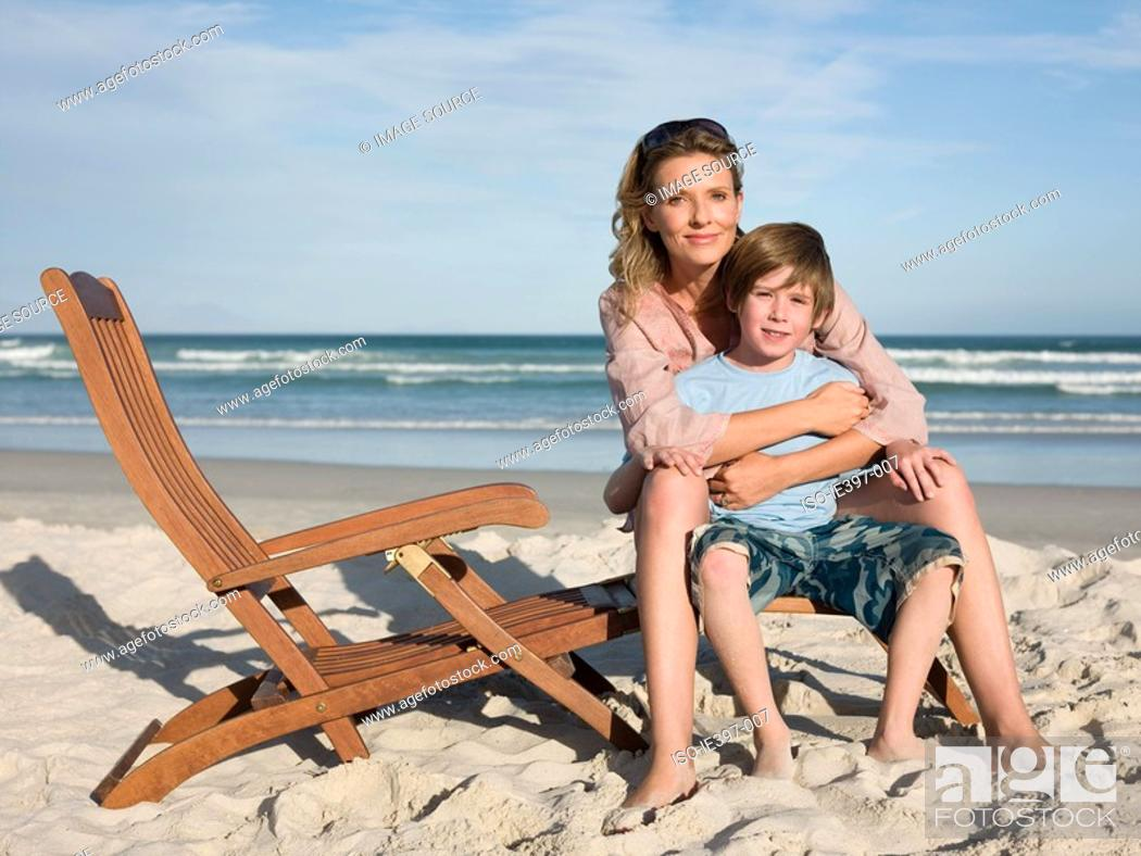 Stock Photo: Mother and son on lounge chair.