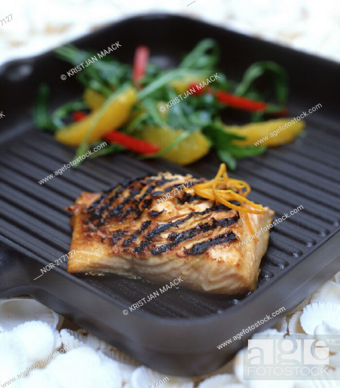 Stock Photo: Meat and vegetables being roasted in a pan.