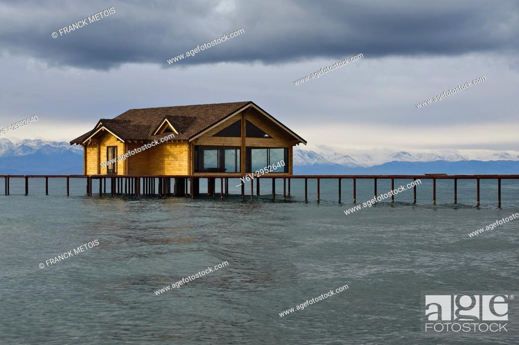 Stock Photo: Bungalow under construction. Lake Issyk Köl ( Kyrgyzstan). The lake is the second largest alpine lake in the world after lake Titicaca.