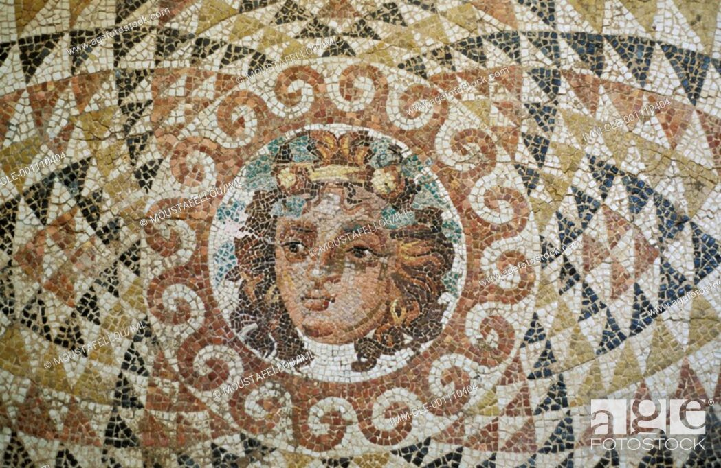 Stock Photo: Mosaic floor decorated with the head of Dionysos framed by ornaments  Ancient Corinth, Peloponnese, Greece.
