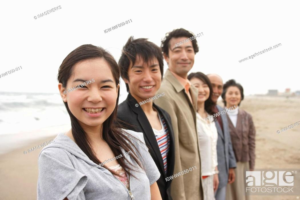 Stock Photo: Family standing together, portrait.