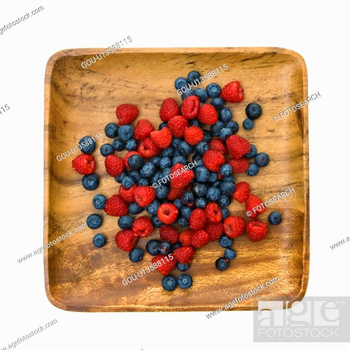 Stock Photo: Platter of mixed blueberries and raspberries.