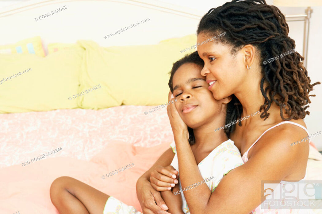 Stock Photo: African mother hugging her daughter.
