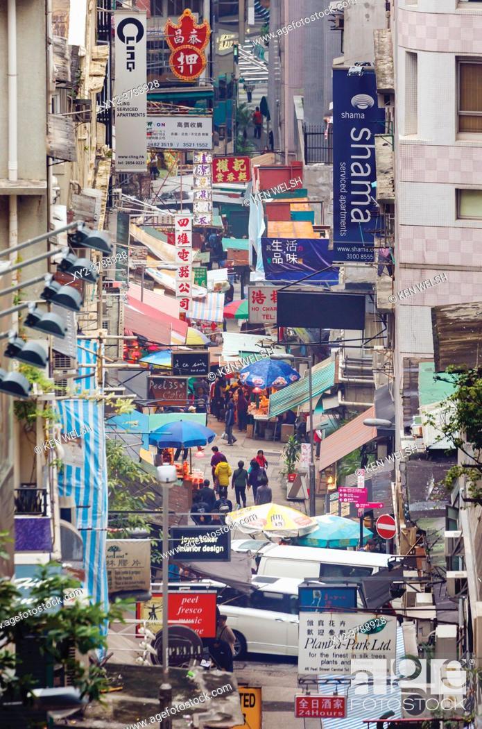 Stock Photo: Hong Kong, China. Peel Street. Street scene with bilingual signs.