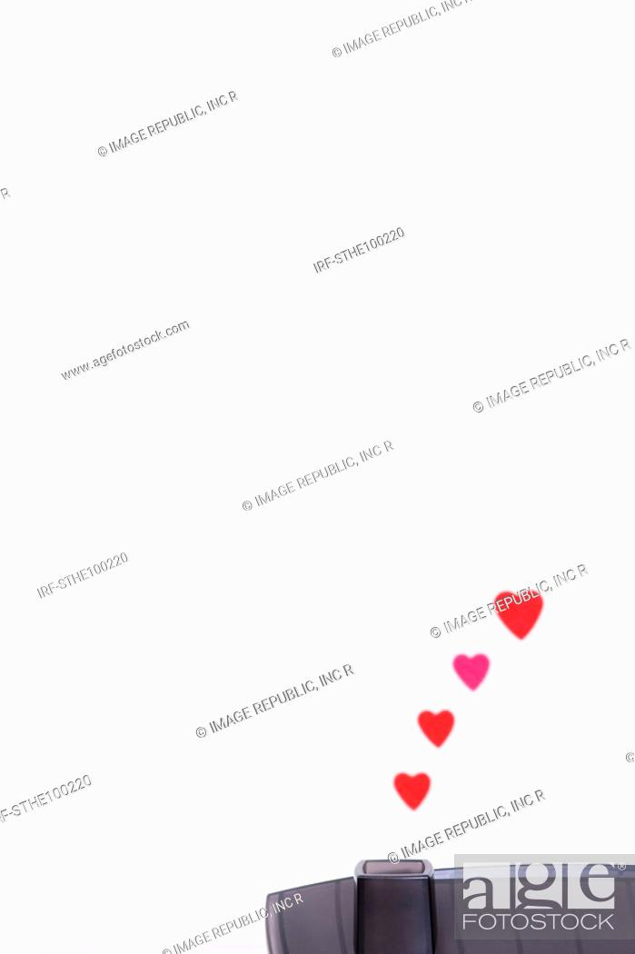 Stock Photo: heart shapes go up from a chimney.