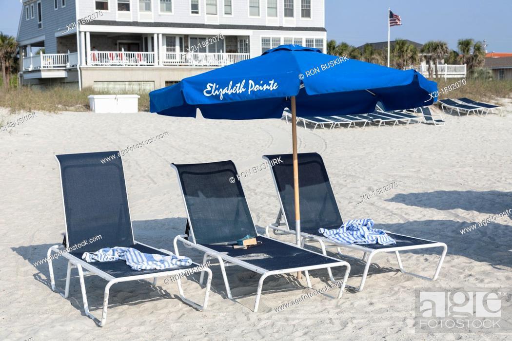 Stock Photo: Beach umbrellas line the waterfront at Elizabeth Pointe Lodge resort hotel at Amelia Island, Florida.