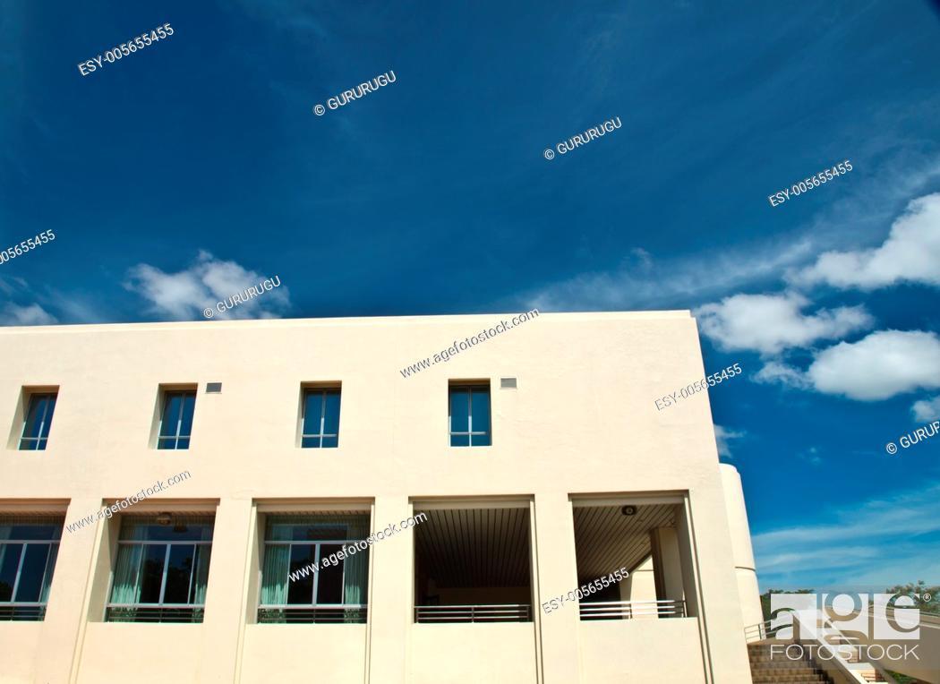Stock Photo: Facade windows of office building on blue sky.