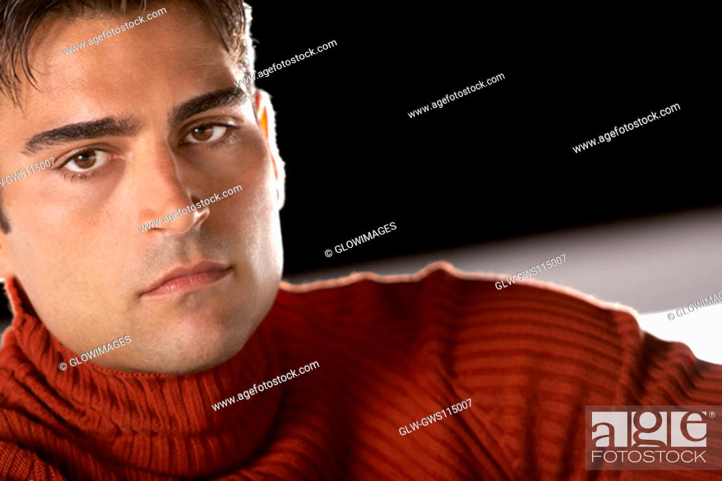 Stock Photo: Portrait of a young man looking serious.