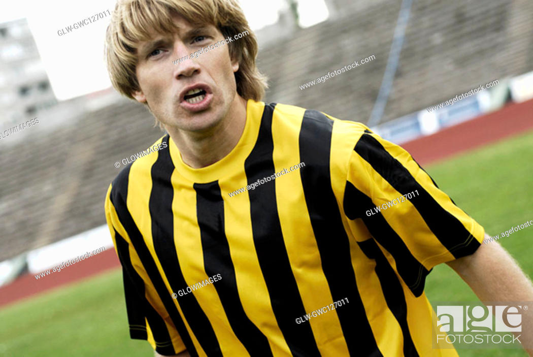 Stock Photo: Close-up of a soccer player in anger.