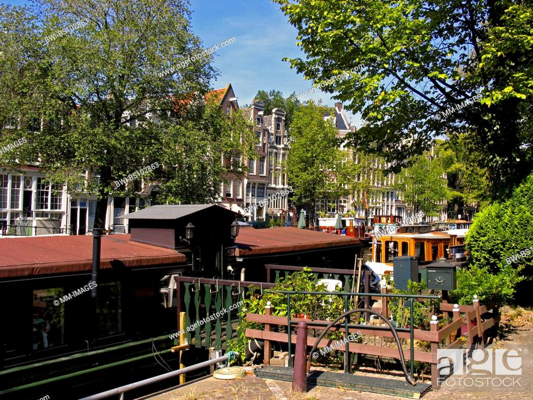 Stock Photo: houseboat at a canal in Amsterdam, Netherlands.