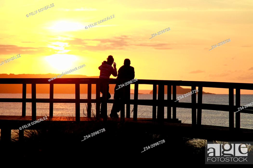 Stock Photo: Couple at El Espartal dune, Asturias Spain.