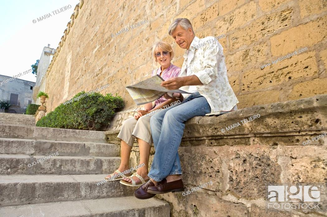 Stock Photo: Man and woman sitting and reading map.
