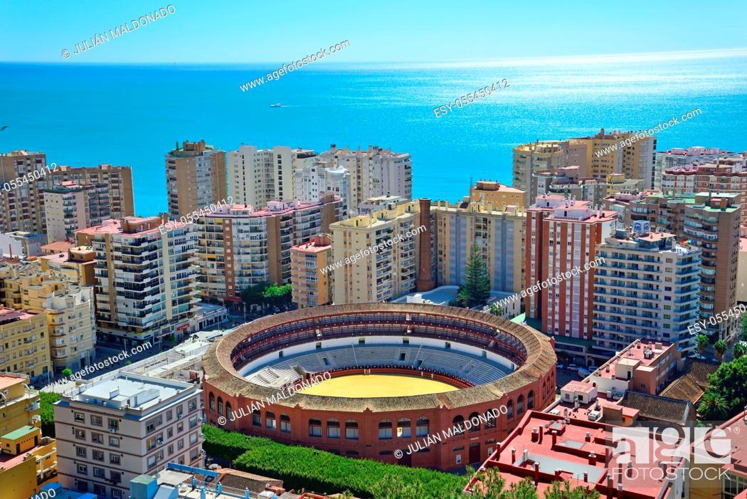 Stock Photo: Malaga, Spain - March 4, 2020: View of the city of Malaga and the La Malagueta Bullring.