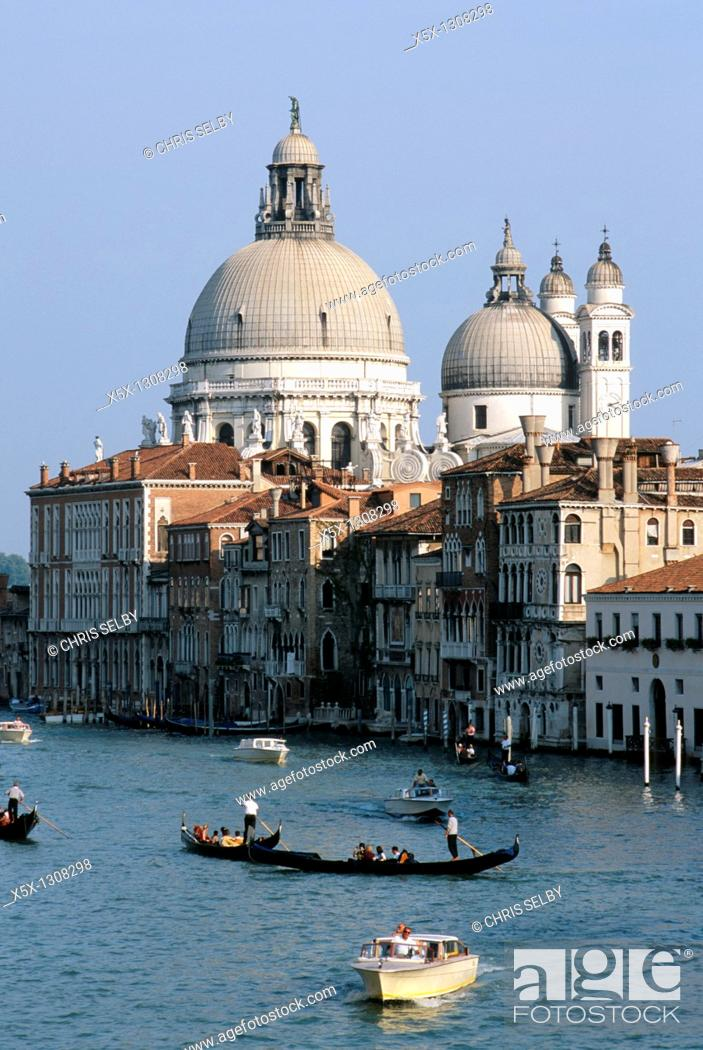 Stock Photo: Gondola and boats on the Grand Canal in front of Santa Maria della Salute church. Venice, Italy.