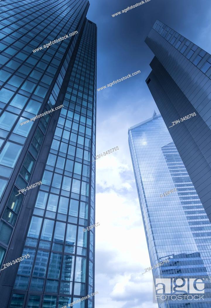Stock Photo: dark clouds over high-rise office buildings, la defense, paris, ile de france, france.
