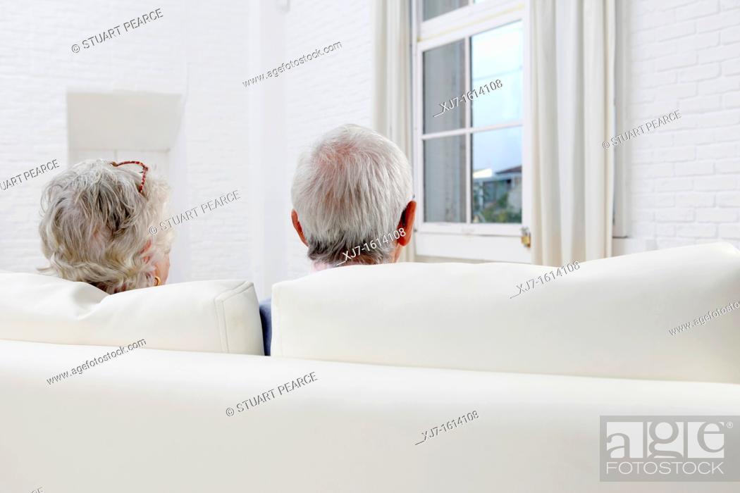 Stock Photo: Senior couple in living room.