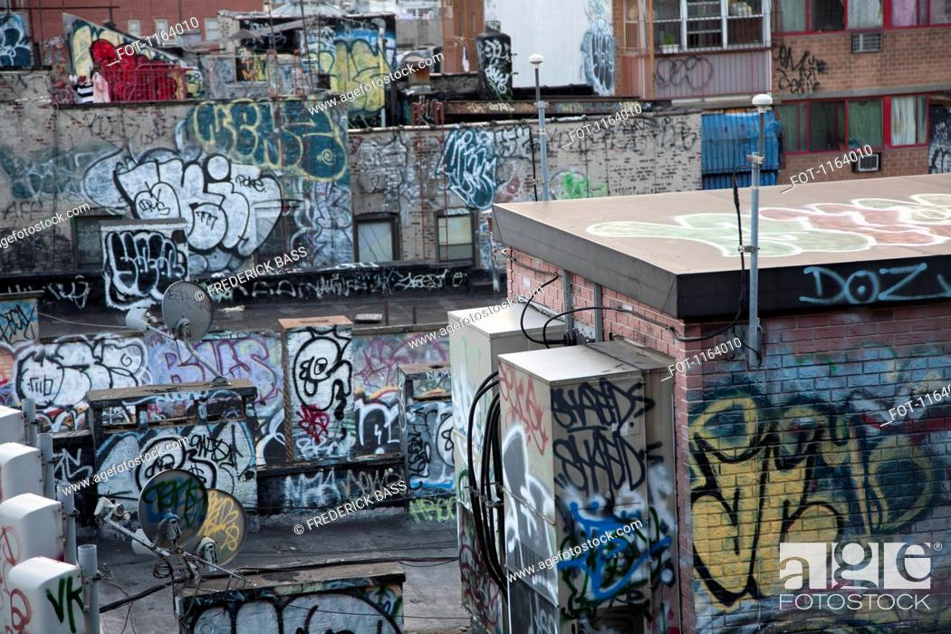 Stock Photo: Graffiti covered tenement rooftop in Chinatown.