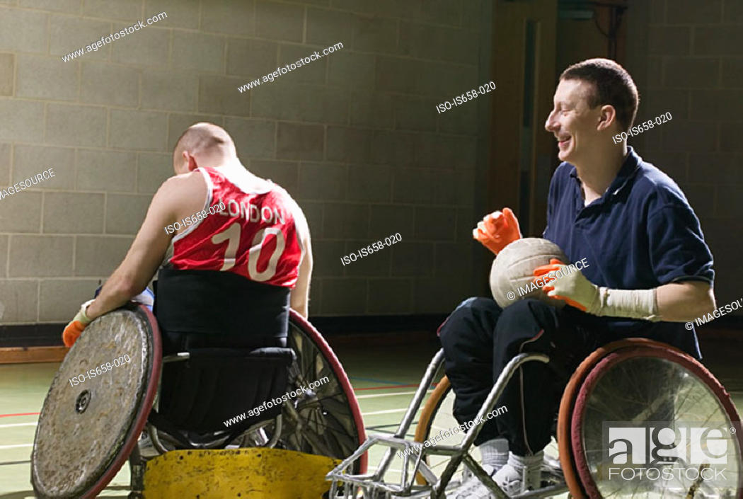 Stock Photo: Men playing basketball.