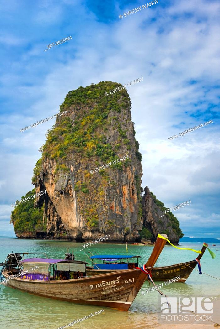 Stock Photo: Rock and longtail boat near Phra Nang beach in Krabi, Thailand.