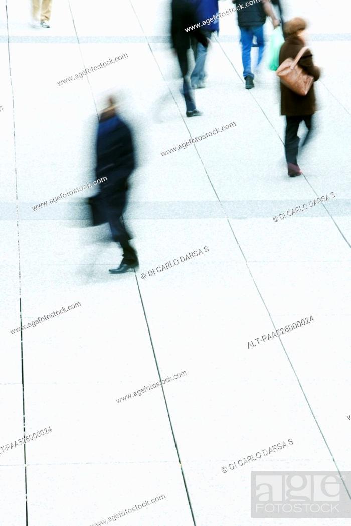 Stock Photo: Pedestrians crossing public square.