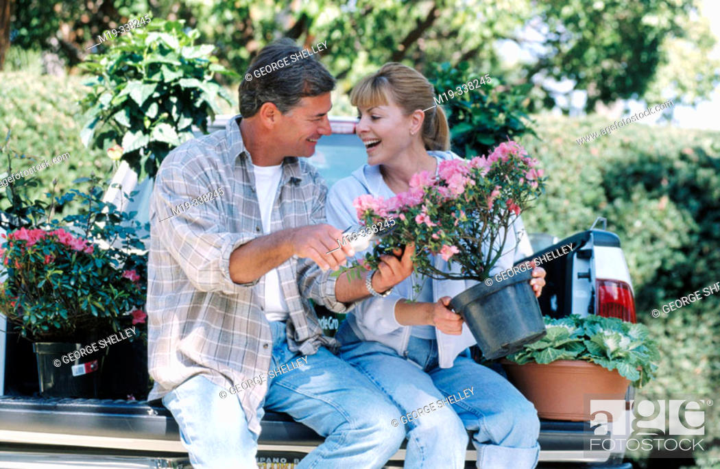Stock Photo: couple with flowers.