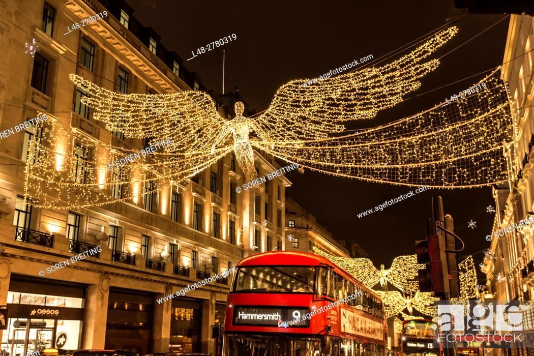 Stock Photo: Street Christmas decoration in Regent Street December 2016 with red busses, lighting angels.