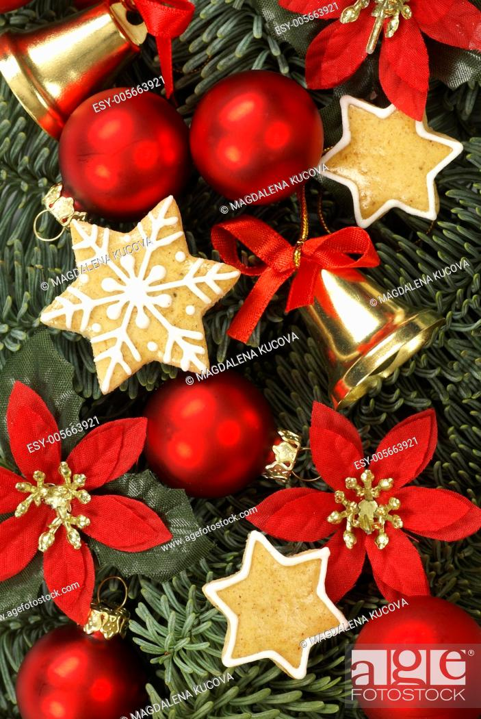 Stock Photo: Christmas decorations and gingerbread cookies on Christmas tree branches.