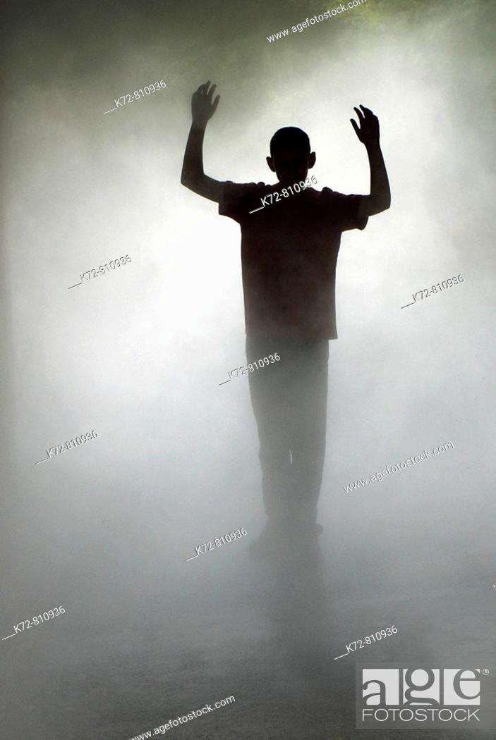 Stock Photo: In a dreamy mist this young man is dreaming he is a hero.