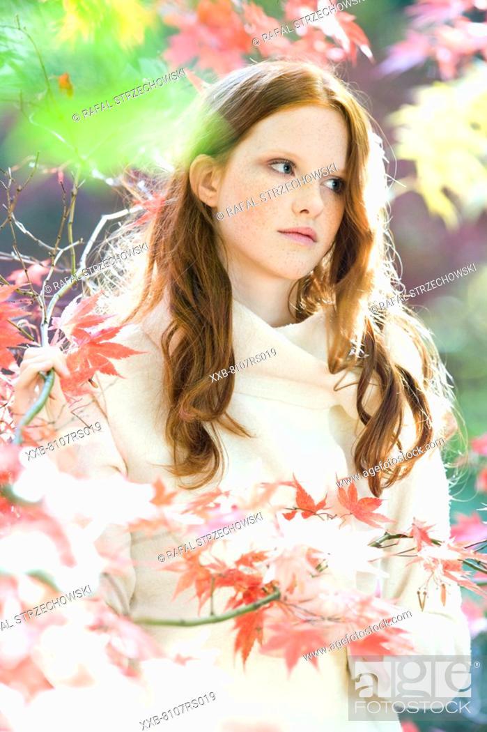 Stock Photo: Autumn portrait of ginger woman.