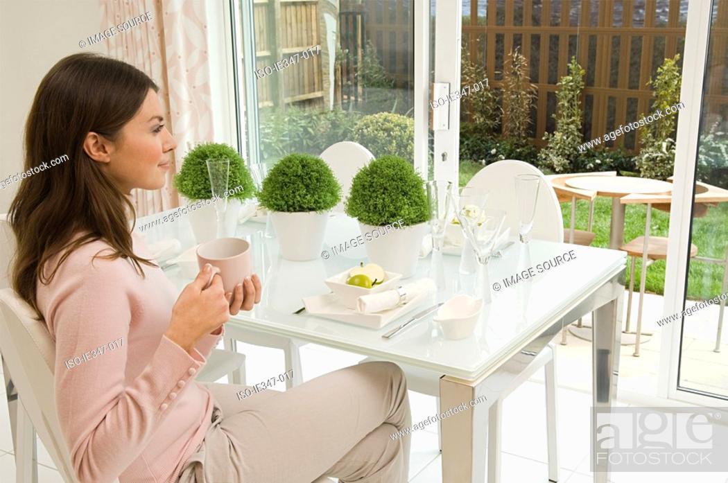 Stock Photo: Woman having a coffee.
