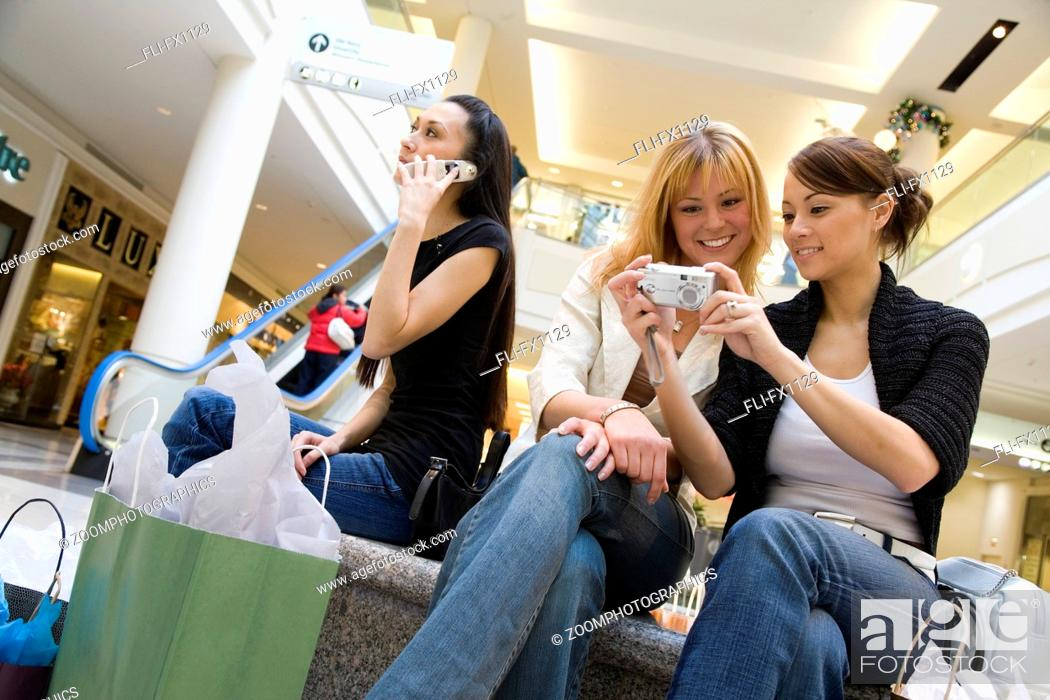 Stock Photo: Girlfriends in Shopping Mall.