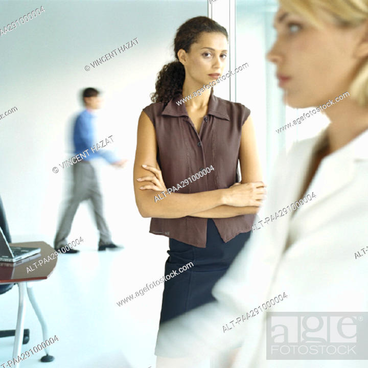 Stock Photo: Businesspeople in workspace.
