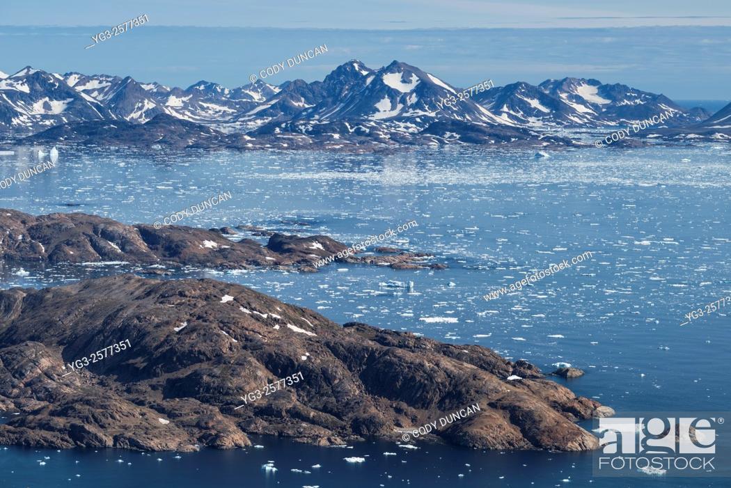 Stock Photo: Late summer sea ice at mouth of Ammassalik Fjord, Tasiilaq, Greenland.