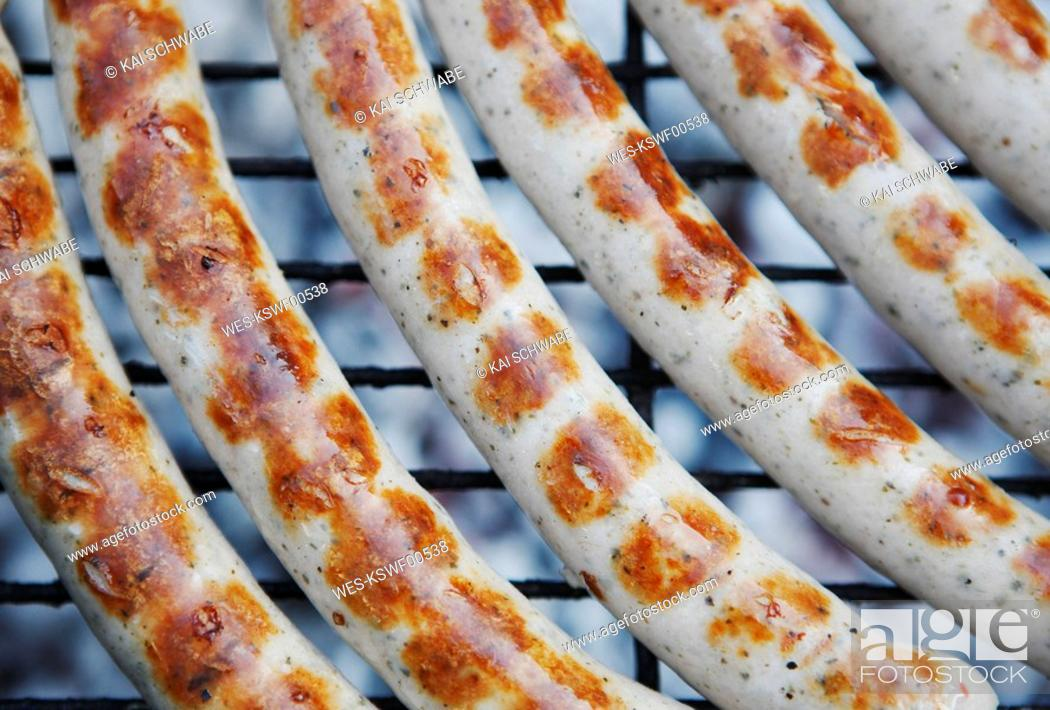 Stock Photo: Fried sausage on grill, close-up.