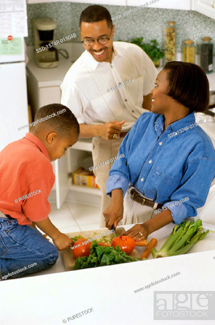Stock Photo: Son helping his mother in the kitchen.