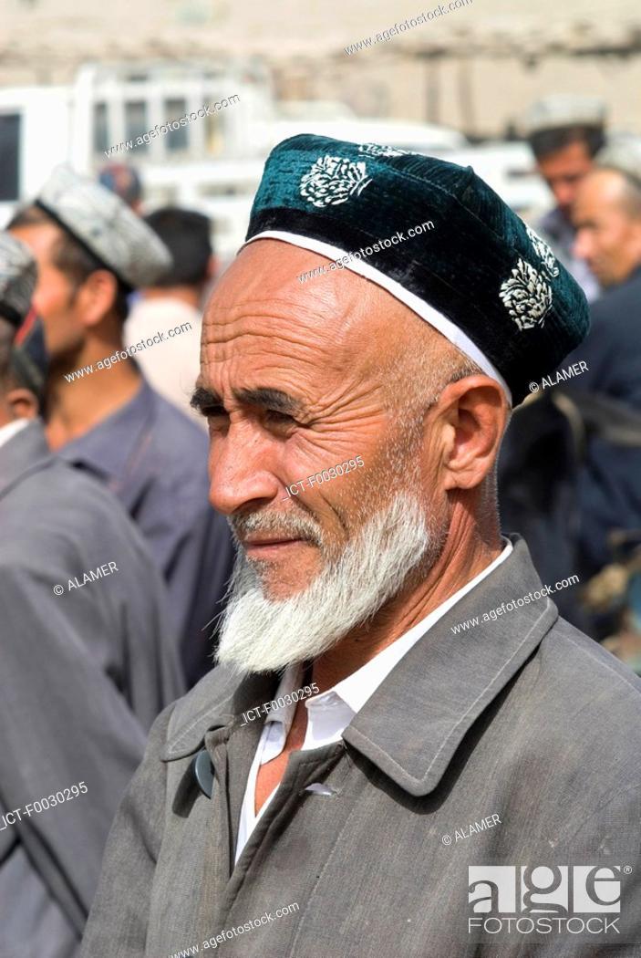 Stock Photo: China, Xinjiang, Keriya, Uyghur man.