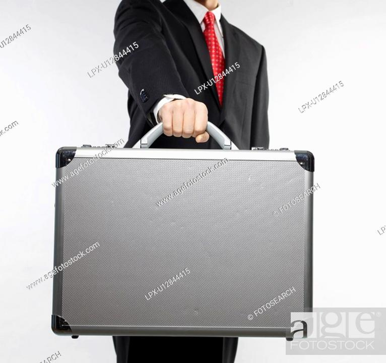 Stock Photo: Businessman Holding Briefcase.