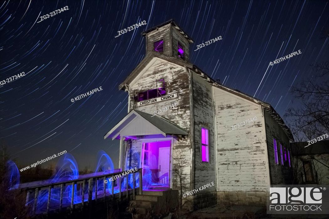 Stock Photo: Star trails and light painting of Abandoned Christian Church in Picher Oklahoma.