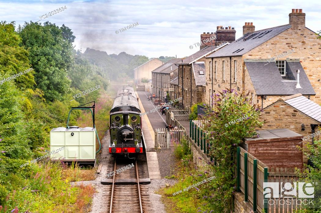 Stock Photo: A steam train engine arrives at the Leyburn Station on the Wensleydale Railway in Leyburn , North Yorkshire, England, Britain, Uk.