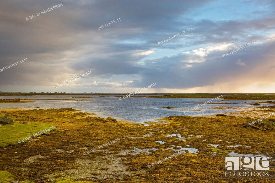 Photo de stock: Tranquil scene clouds over lake, Loch Euphoirt, North Uist, Outer Hebrides.