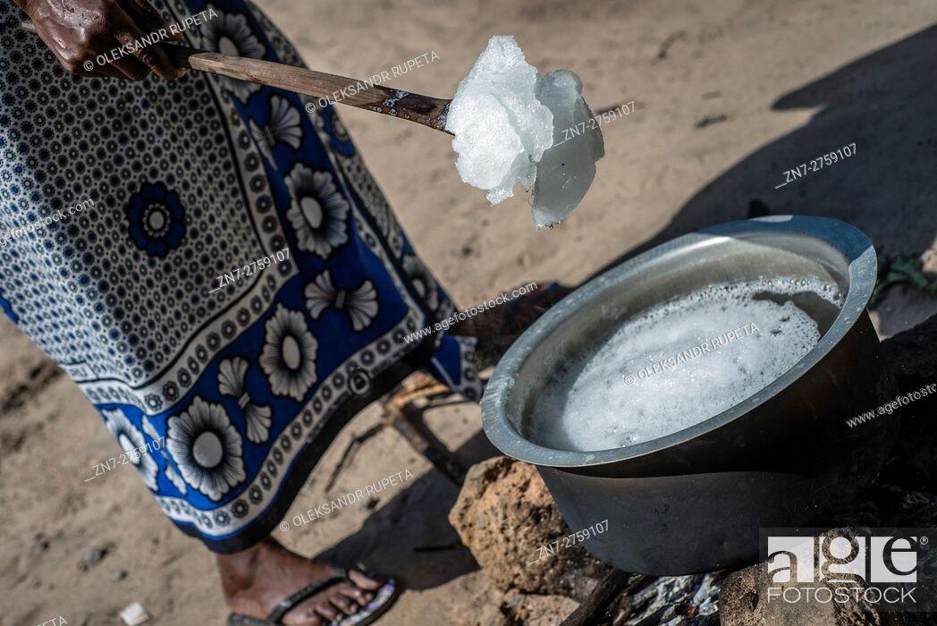 Stock Photo: A housewife prepares liquid soap for selling in the market in Visiga Kwa Kipofu near Dar Es Salaam, Tanzania.